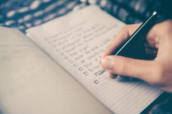 notepaper and pen writing cheat sheet list
